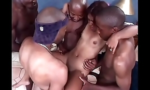 Asian slattern mouth fucks four black cocks