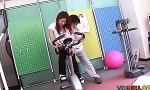 VODEU - Petite Asian babe receives drilled by the trainer
