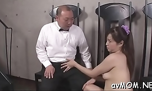 Dirty milf dangles two big schlong and balls greater than her lips