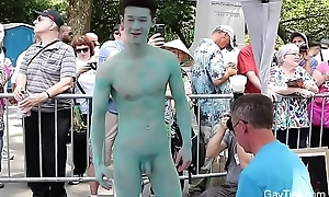 Naked Asian Lad'_s body is painted with regard to public