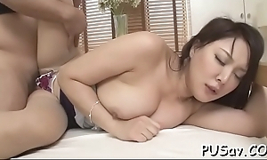 Glamorous asian enjoys her nipples pinched and bore slapped