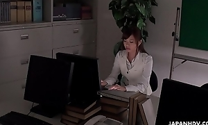Office worker getting some juice anent as her work gets boring