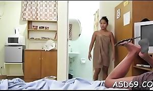 Diminutive thai babe rides a 10-pounder