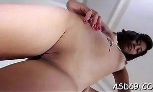 Miniature oriental Freulein gives a blow