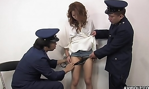 A sexy prisoner getting her drenched pussy handled by guards