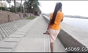 Grotesque asian doxy in a hot act