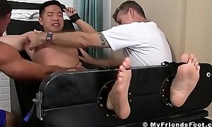Downcast Oriental Cooper Dang gets his suckable feet tickled hard