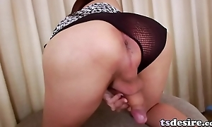 Enticing Asian Tranny Chanel C Strokes Her Cock