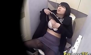 Rubbing asian babe pisses