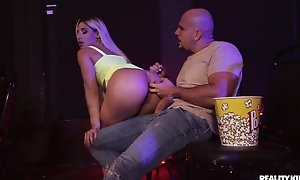 Blonde-haired bitch gets anally drilled in the cinema